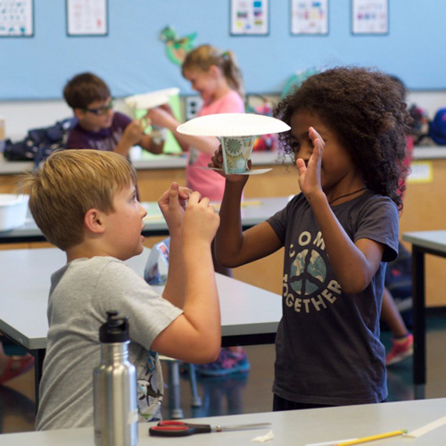 Kids constructing lunar lander in aerospace engineering camp
