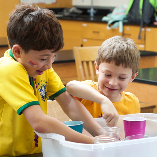 Two boys mix chemicals in the chemical engineering camp